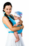 Mother carrying her baby in a sling Stock Images