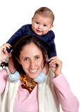 Mother carrying her child Stock Photo
