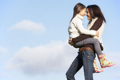 Mother Carrying Her Daughter Royalty Free Stock Photo