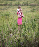 Mother carrying her daughter on shoulders Royalty Free Stock Photo