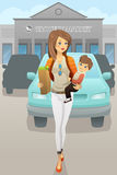 Mother carrying her son and grocery bags Royalty Free Stock Photo