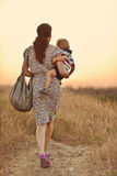 Mother carrying son Royalty Free Stock Image