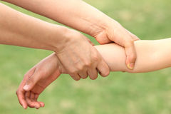 Mother catch child arm Royalty Free Stock Images