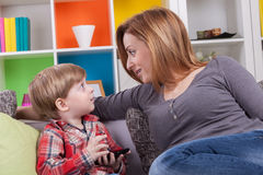 Mother catch the child to play by her phone Royalty Free Stock Photos