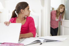 Mother Catches Daughter Using Laptop When Meant To Be Studying Stock Image
