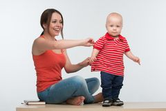 Mother catching active little kid Royalty Free Stock Photos