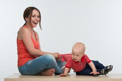 Mother catching active little kid Stock Image