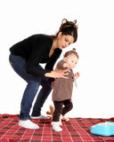 Mother catching little daughter. Stock Images