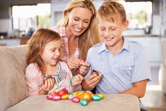 Mother celebrating Easter at home with kids Stock Images
