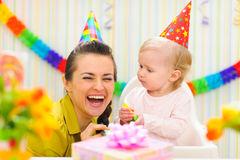 Mother celebrating first birthday of her baby Royalty Free Stock Photos