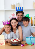 Mother celebrating her birthday with her family. Happy Mother celebrating her birthday with her family at home stock photography