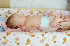 Mother change diaper. To her newborn baby royalty free stock photography