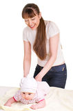 Mother changing babies cloth diaper. Royalty Free Stock Photography