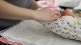 Mother changing babies clothes. Hd stock video footage