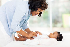 Mother changing baby's diaper Stock Photography