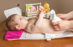 Mother changing diaper of adorable baby Stock Photo