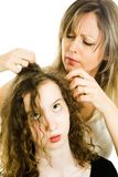 Mother checking child`s head for lice - louse on head stock images