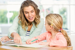 Mother checking daughters homework Royalty Free Stock Photography