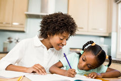 Mother checking daughters homework Stock Photo