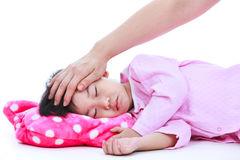 Mother checking temperature of sick daughter by hand. Isolated o Royalty Free Stock Images