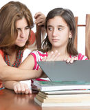 Mother checks her daughter internet activity Royalty Free Stock Photography