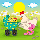 Mother chicken with chickens in stroller Royalty Free Stock Image