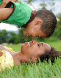 Mother and Child. Happy smiling African American mother and child in park Stock Image