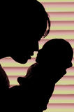 Mother and child. A new mother caresses her newborn child Stock Photo