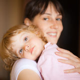 Mother with child. Little child with mom - shallow DOF, focus on little girl's eyes Royalty Free Stock Image