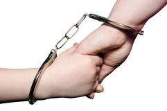 Mother and child. The photo shows a hand mom and baby associated with handcuffs Royalty Free Stock Photos