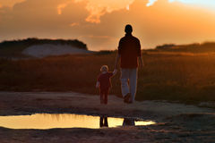 Mother and Child. Walking on the beach during sunset stock images