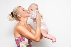 Mother and child. On white Royalty Free Stock Photography