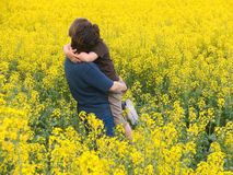 Mother child. Mother and her son with yellow flowers Stock Photos