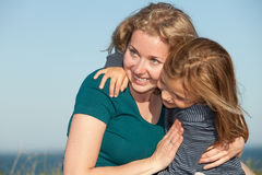 Mother and child. Portrait of a happy mother and her little daughter outdoors Royalty Free Stock Photos