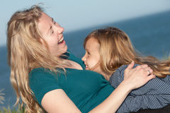 Mother and child. Happy mother and her little daughter having fun outdoors Stock Photos