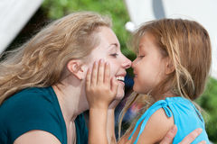 Mother and child. Mother and daughter hugging and smiling Royalty Free Stock Photos