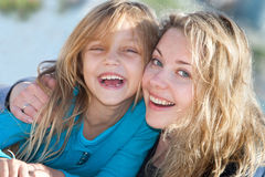 Mother and child. Portrait of a happy mother and her little girl outdoors Stock Photography