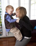 Mother and child. Beautiful mother and her cute son play together at home royalty free stock images