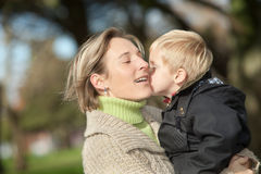 Mother and child. Mother and her little boy outdoors royalty free stock photo