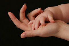 Mother and Child. Child touching mother's hand Stock Images