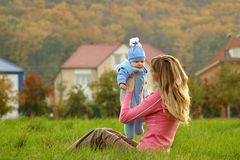 Mother and child. On background of the house Stock Photo
