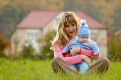 Mother and child. On background of the house Royalty Free Stock Photo
