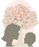 Mother and child. Talking near apple tree in bloom royalty free illustration