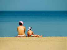 Mother and child. On the beach Stock Photos