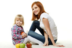 Mother and child with apples. Royalty Free Stock Photo