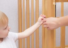 Mother and child are assembling a crib, close-up, caucasian, installation royalty free stock photos