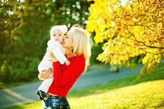 Mother with child in autumn day. Happy mother with child in autumn day Stock Image