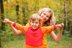 Mother and child in autumn forest Royalty Free Stock Photos