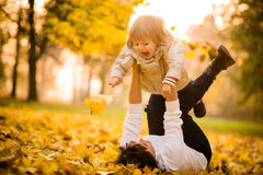 Mother and child - autumn fun Stock Photos