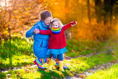 Mother and child in autumn park Stock Images